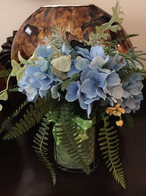 Blue hydrangeas with a butterfly