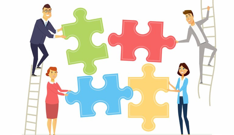employees holding puzzle pieces showing a building of culture