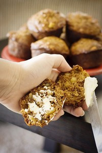 Buttered and whole apple bran muffins.