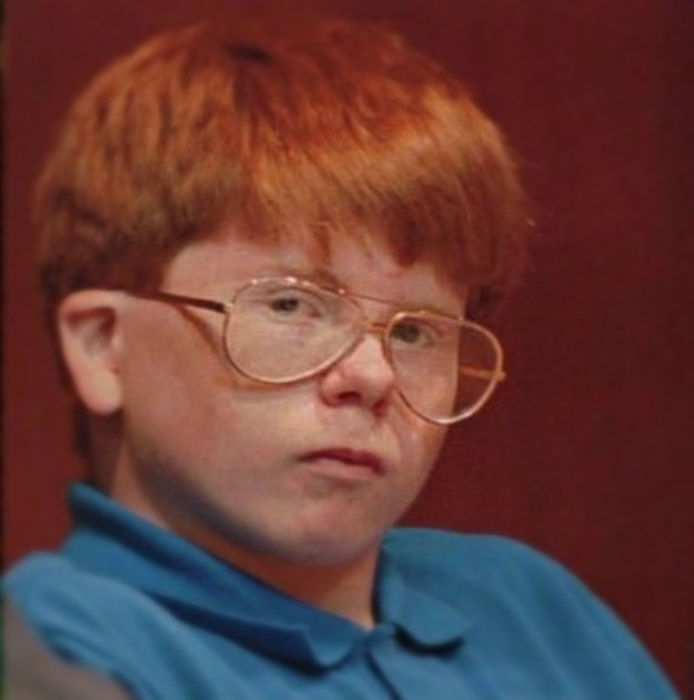 Eric Smith with red hair and glasses at his trial