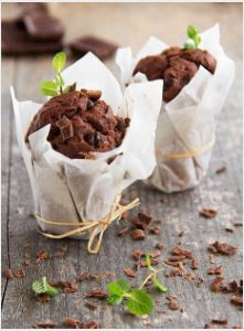 2 chocolate chip banana muffins in paper cases tied with string.