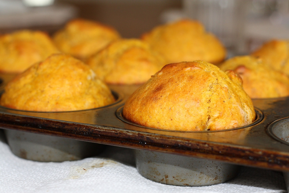 A tray of freshly baked cheese and bacon muffins.