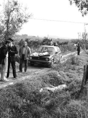 Stefano Baldi's body next to the car lying in a ditch.