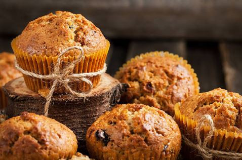 Wholemeal carrot and raisin muffins decorated with string bows.