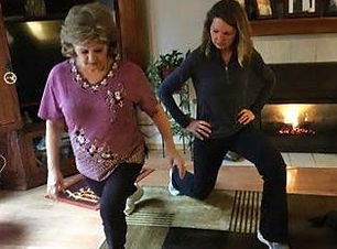 Veronica showing a client a lunge exercise