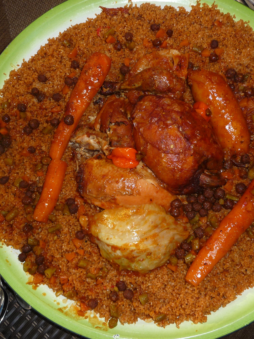 Thiebou dien is Senegal's national dish. Fish and vegetables with slow-cooked, red rice, eated communal style.Delicious !!