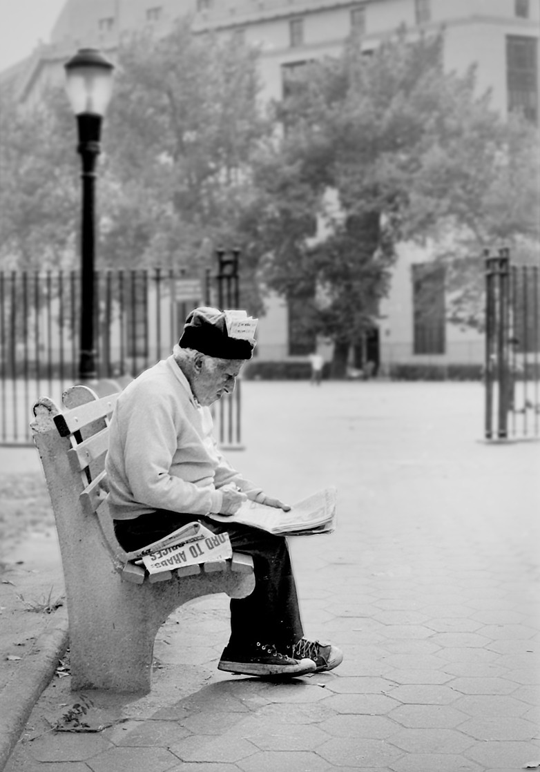 Reading the newspaper, Columbus Park, NYC 1974