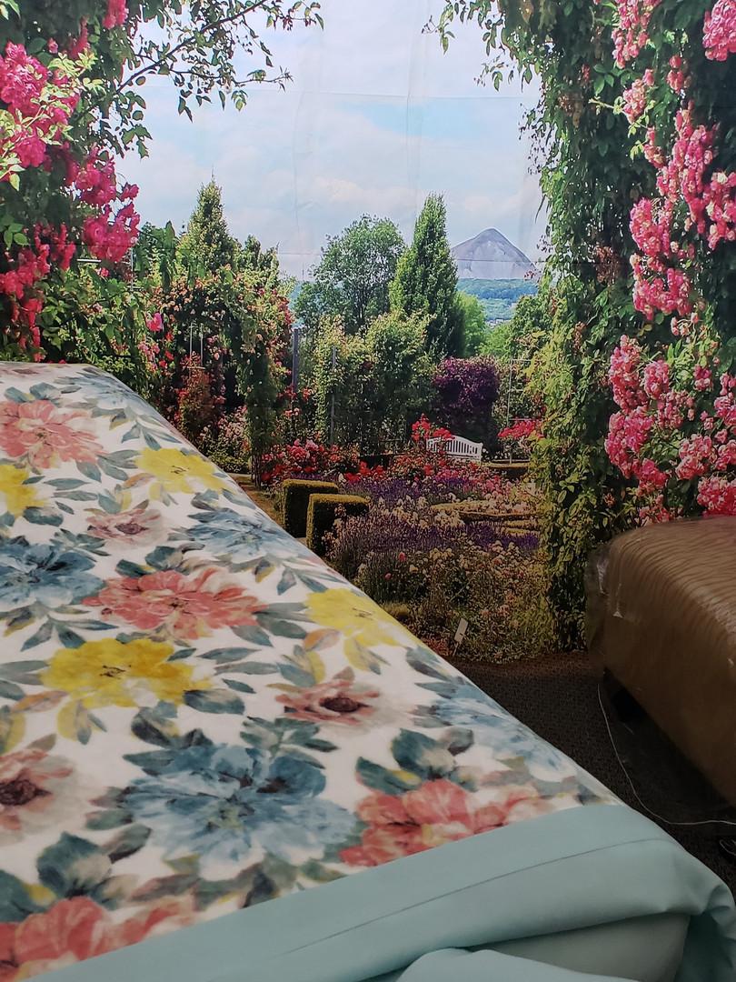 Massage table with garden scene