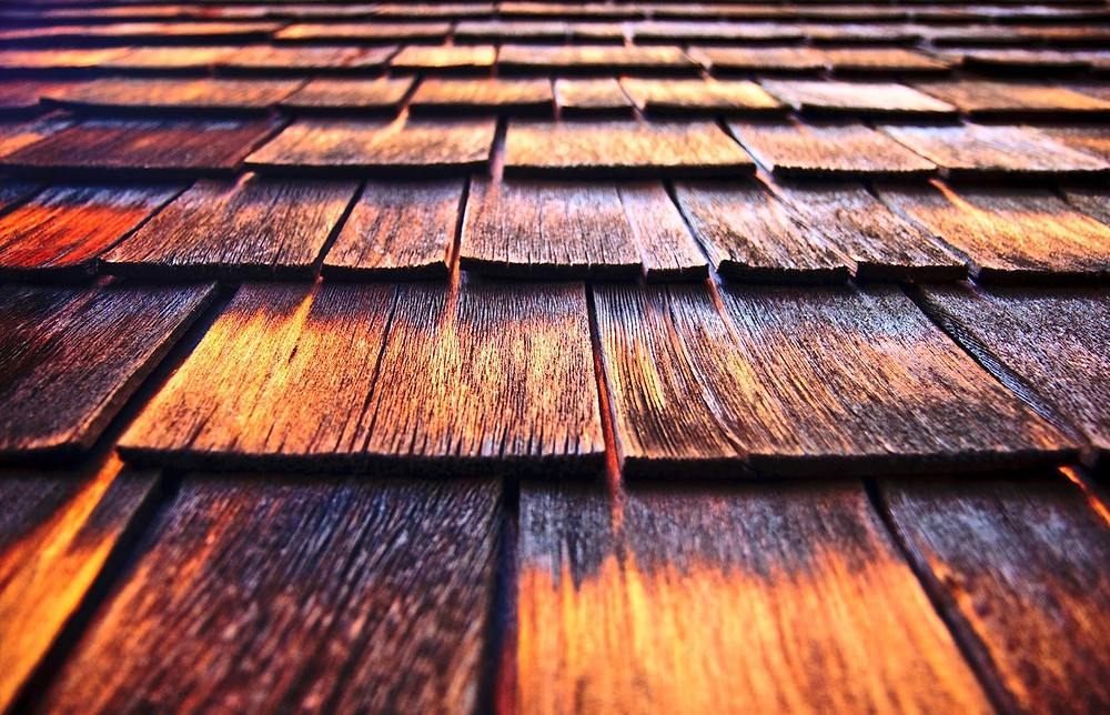 A close-up on wooden shingles shows them in good condition