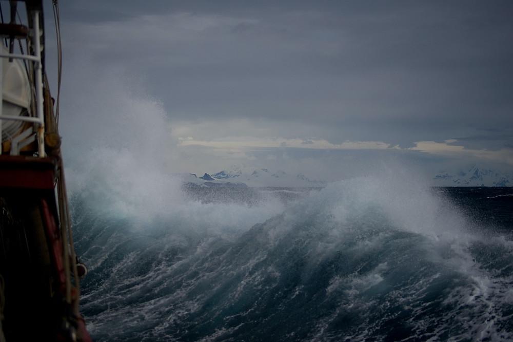 Violent waves crash against a pier