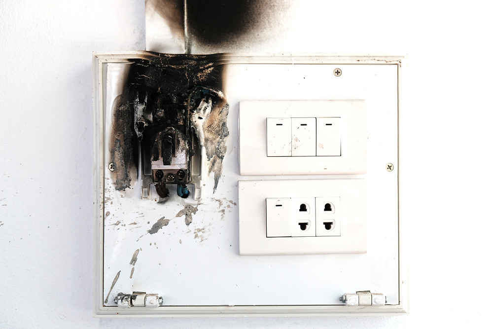 A switch has remnants of fire damage after getting too hot