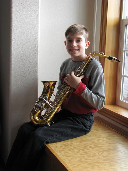 2007: Begins Playing Saxophone