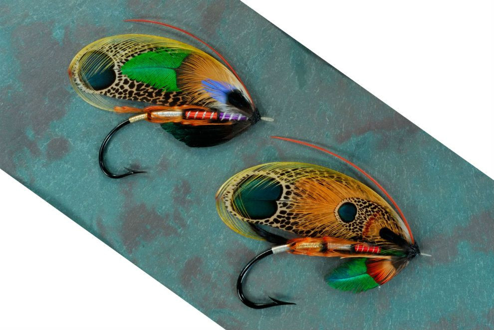Image of two fishing hooks decorated with beautiful feathers.