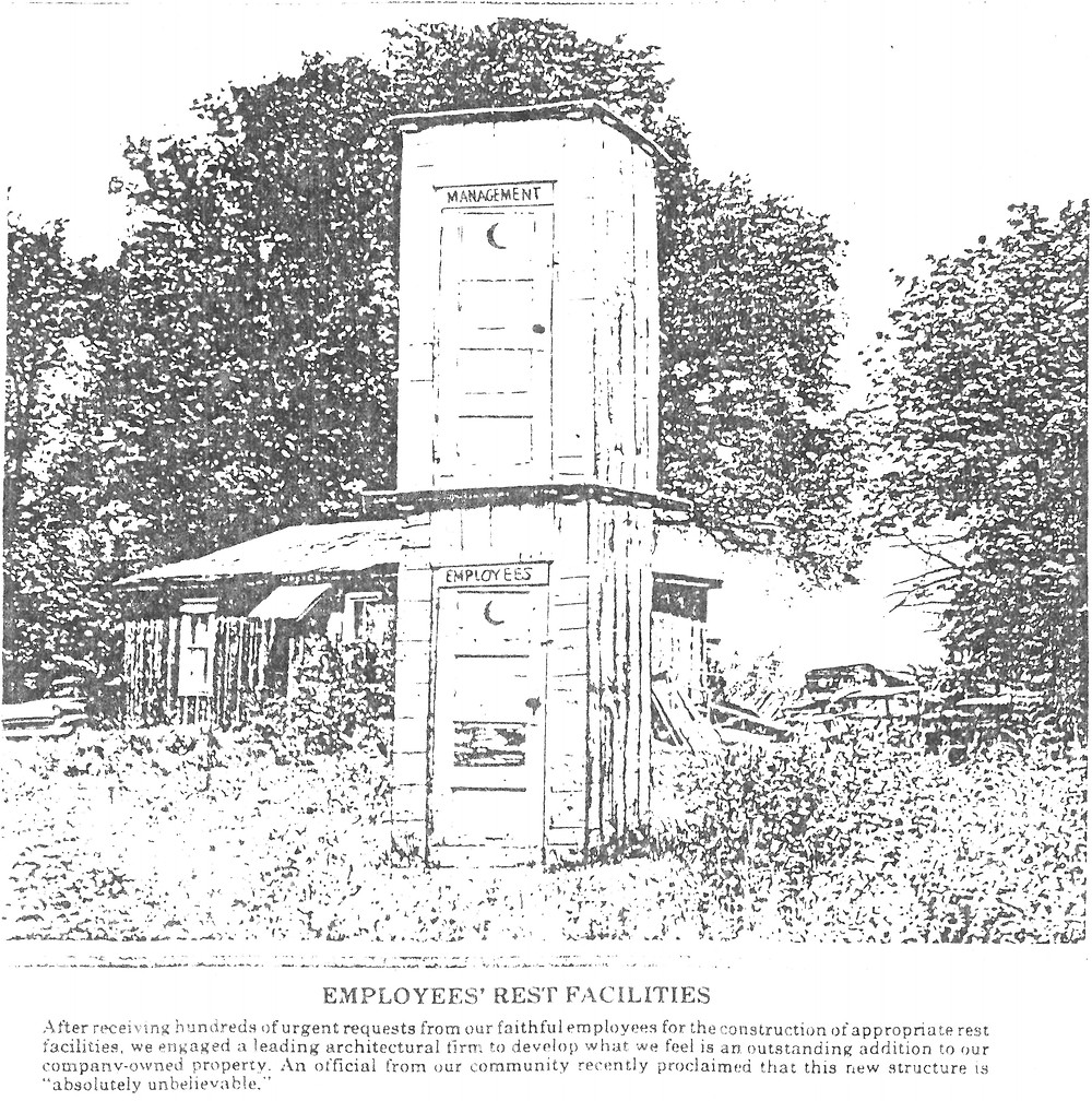 An image of two outhouses stacked on top of each other.
