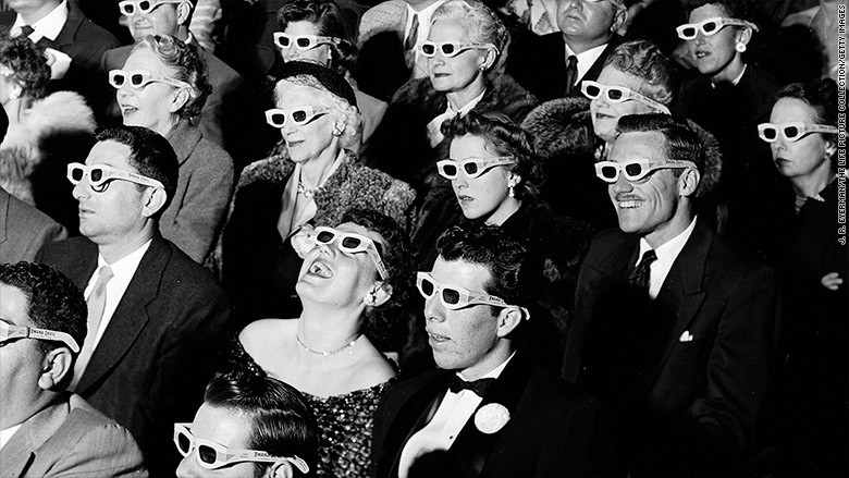 Crowd of theater-goers wearing 3D glasses