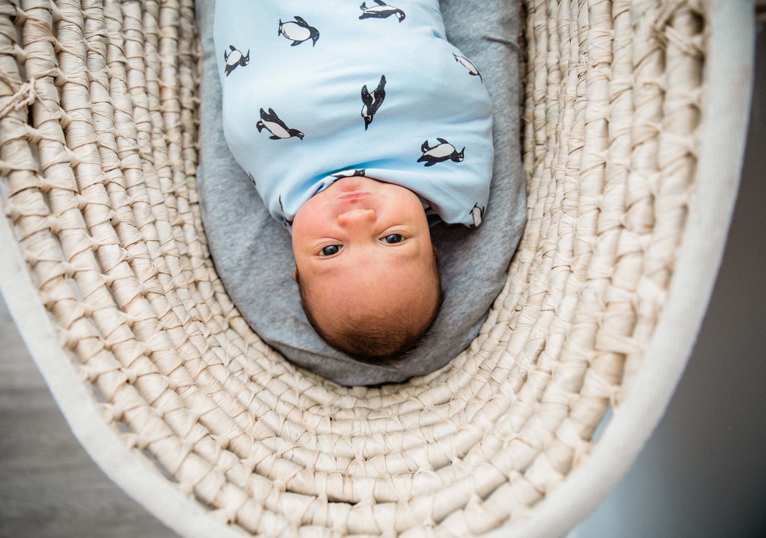 newborn in bassinet