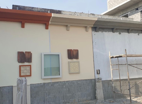 Installation of decorative aerated concrete cornices in progress at Al Khawaneej