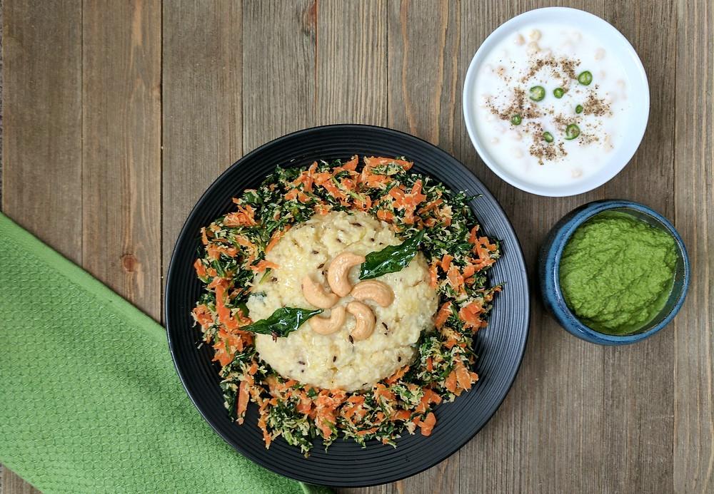 Image of millet pongal, carrot arugula poriyal, and sides