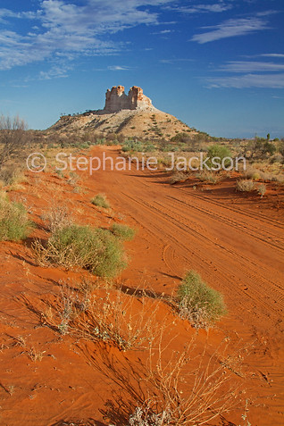 Outback road and landscape dominated by Castle Rock in outback Australia - IMG 5740