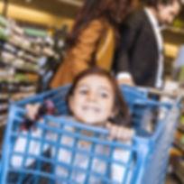 Public behavior coaching child in grocer