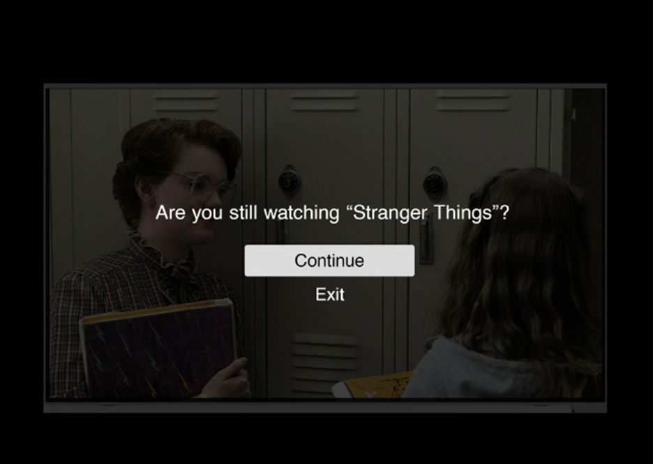 A pop up messages reads: Are you still watching Stranger Things? with the command options Continue/Exit