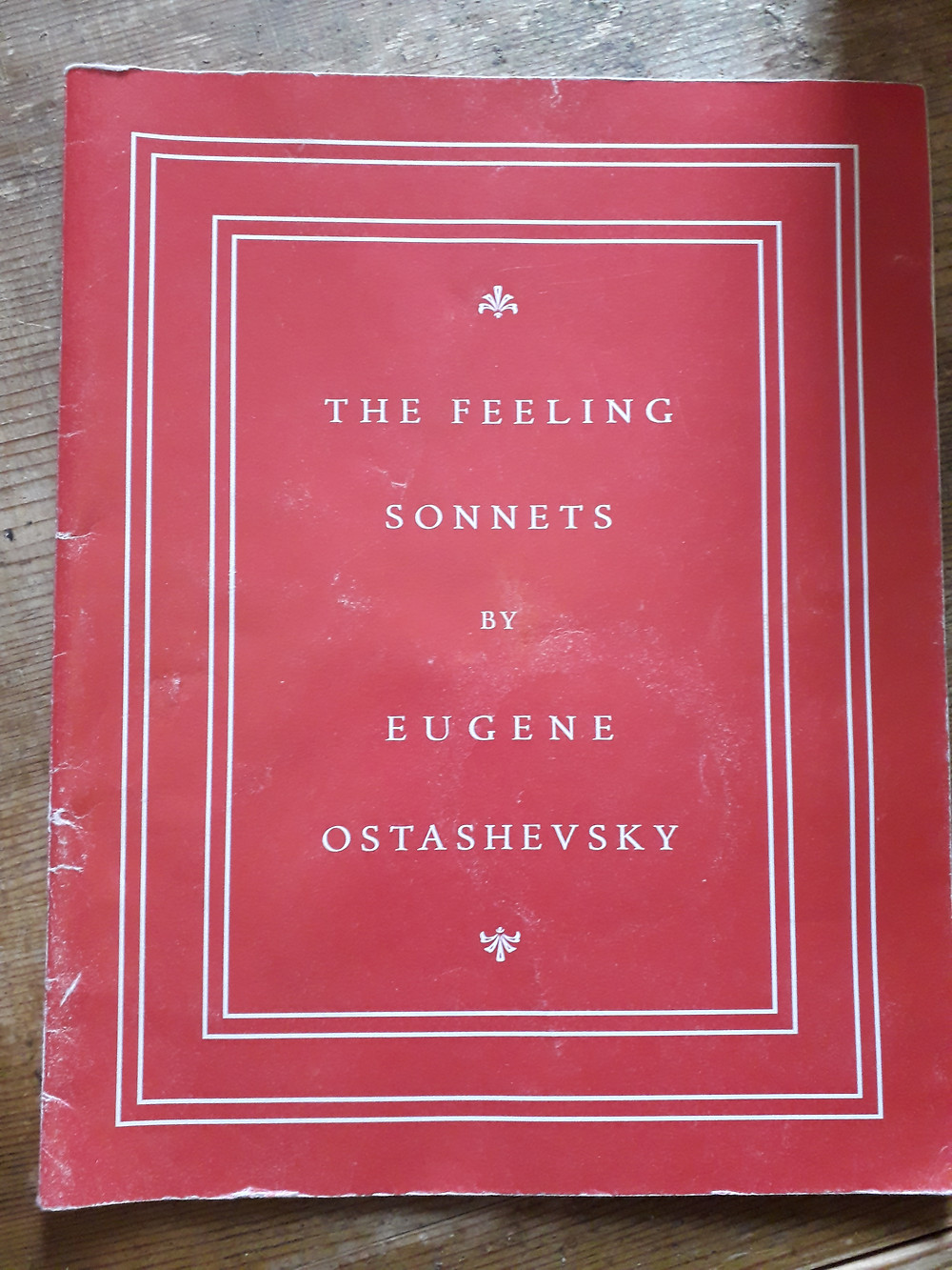 Red-coloured book cover for The Feeling Sonnets