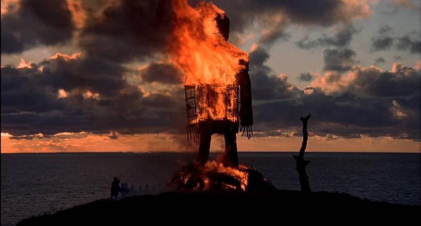 a blazing wickerman set against dusk skies