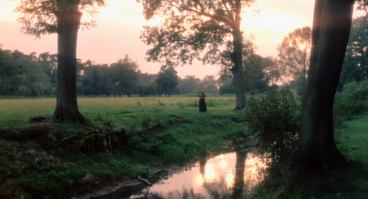 pastoral scene by river at dawn; single dark figure is seen wearing long skirt in middle ground