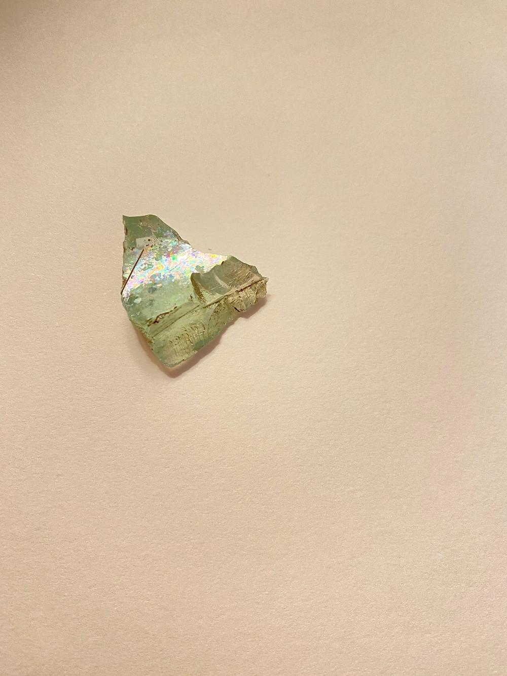 Iridescent glass shard, found in a medieval churchyard garden, Norwich