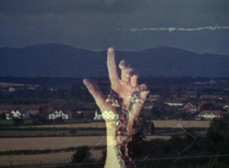 a large double exposed hand points skyward