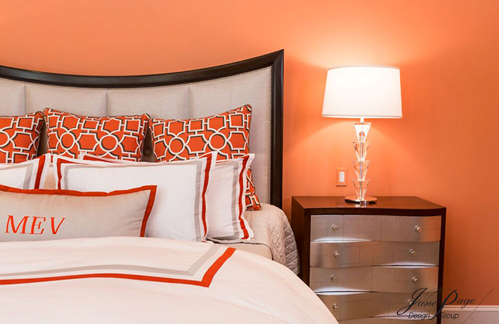 Bold Bedroom Design with Persimmon Walls and Bedding Accents