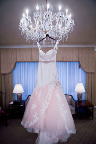 This dress began in ivory, then we added blush and a lot of custom beadwork. A beautiful dress for a beautiful bride!