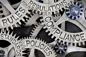 Meshed-Gears-that-Say-Rules-Regulations-