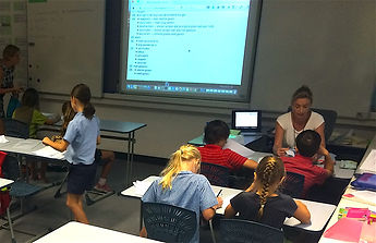 students working in their workbooks in a classroom at Discovery Bay Dutch Institute