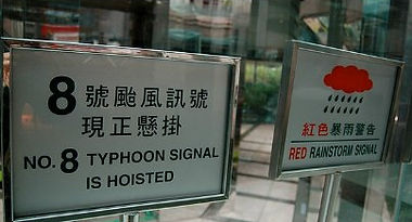 Signs with typhoon warning and red rainstorm signal