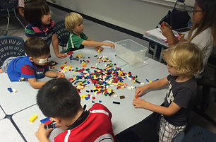 young students playing with lego