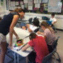 teacher helping Dutch student in classroom