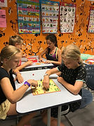 Dutch class with children and a teacher