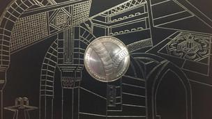 AUC Centennial Coin