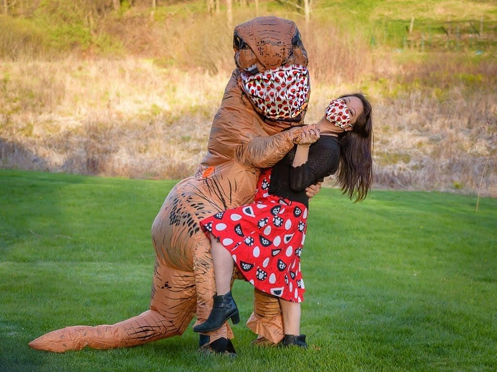 Dinosaur Costume dancing wearing mask