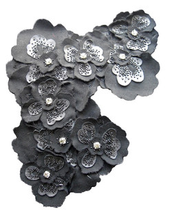 Leather and wool flowers with jewels