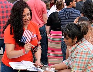 Latina registering immigrant to vote, civic engagement, America