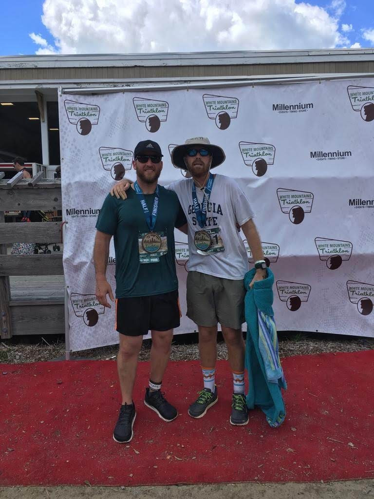 Finishing the White Mountain Triathlon with my college friend