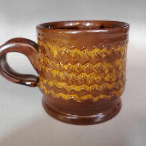 3.5' x 3.5' Kaki glazed stoneware cup with Vegas Gold highlights.