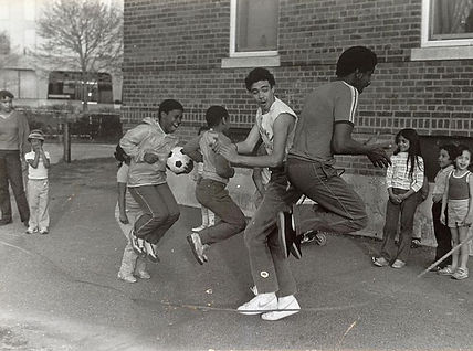 Young people are having fun and playing together outside in the 1970's