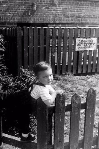 A young boy hangs out in Hanging out in Newtowne Court in the 1950's