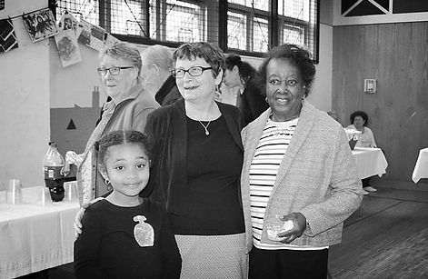 A young girl, an adult woman and an older woman are attending a party at the Community Art Center