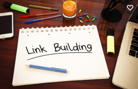 Link Building words written on tablet