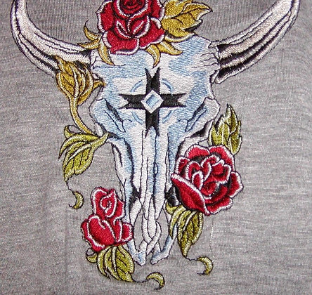 SKULL WITH ROSE. This is just a sample of the Embroidery we do.