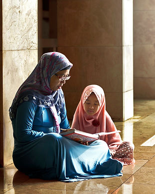 Mom Reading a Book to her Daughter